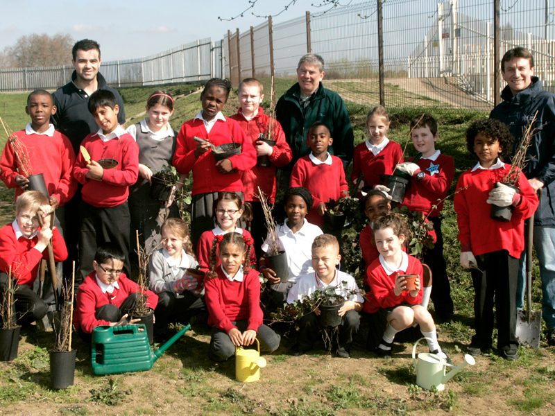 Group of school children enjoying an educational session at a Land Trust site