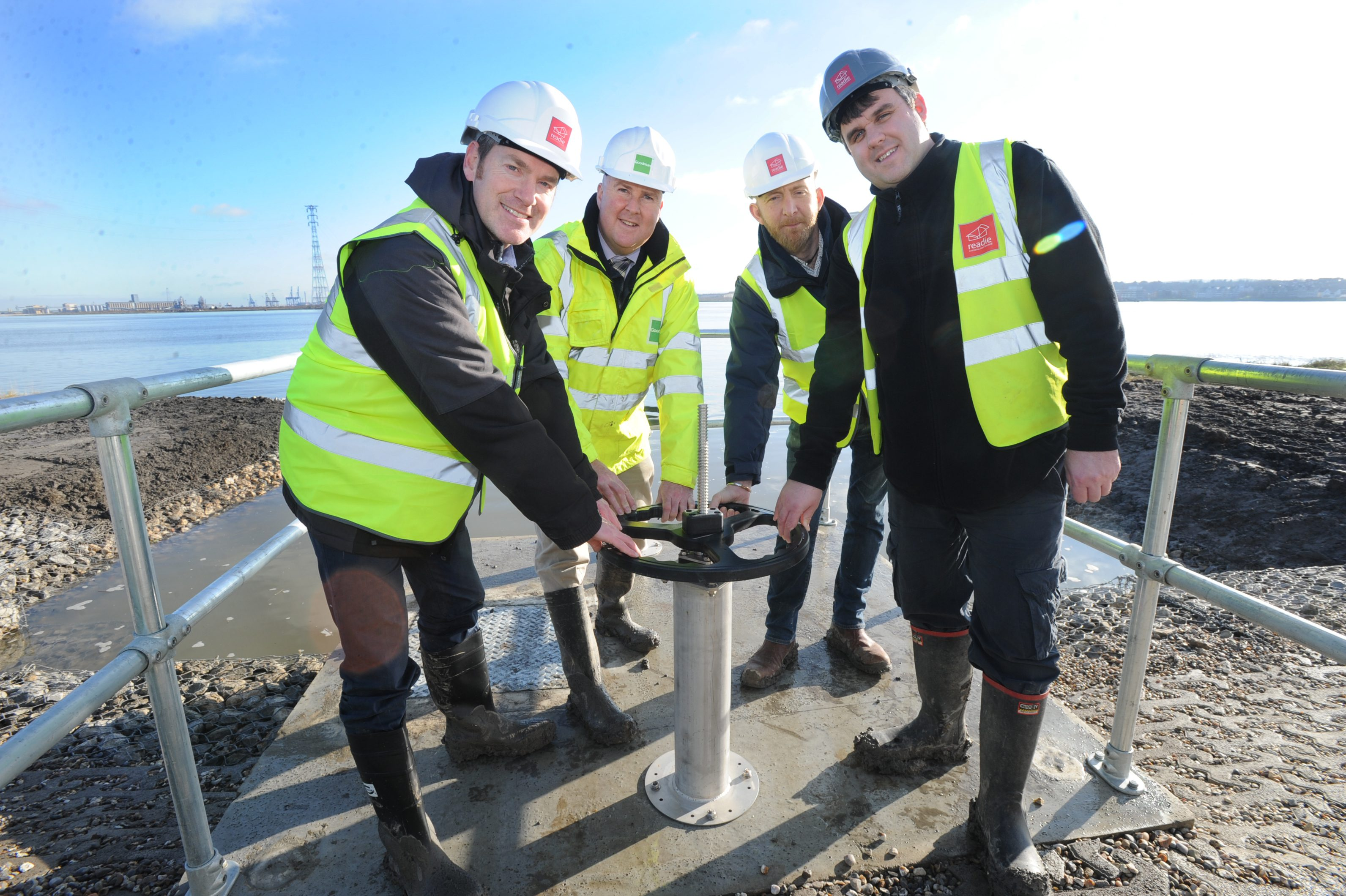Work with the Land Trust: environmental officers opening the inlet valve to allow the river Thames water into the Oliver Road Lagoons development in Essex