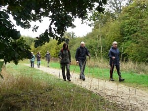 A group of Nordic walkers engage in health activities at a Land Trust site